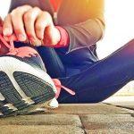 Woman lacing up trainers to run Run Mummy Run