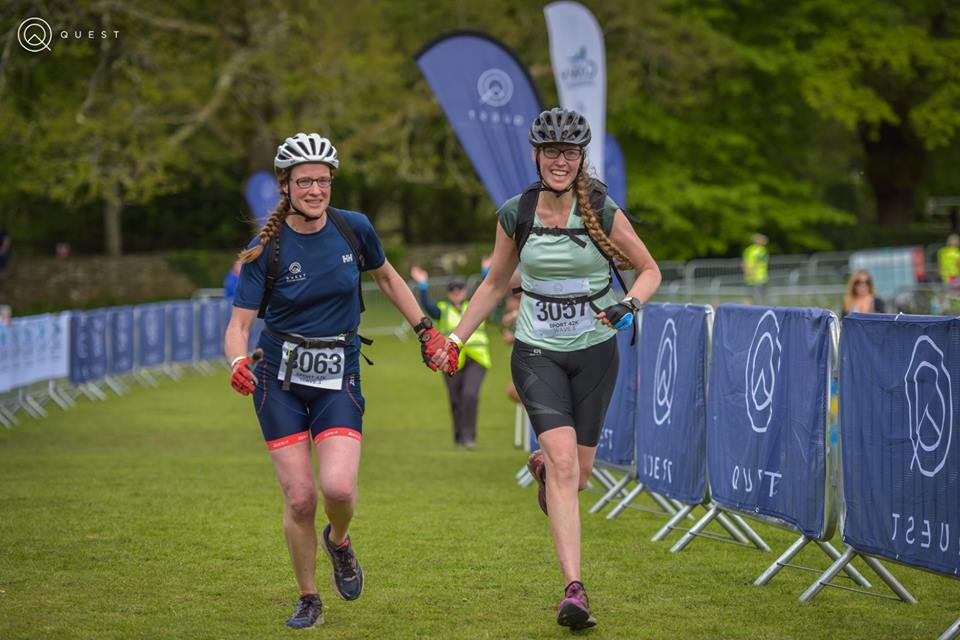Women finishing Adventure Race hand in hand Run Mummy Run