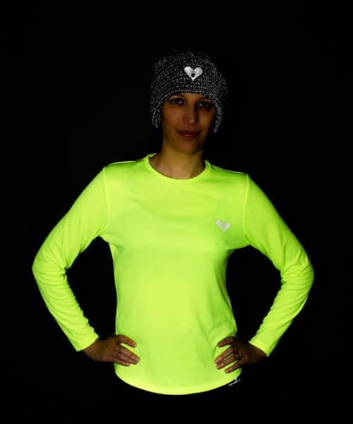 Runner wearing reflective kit in the dark