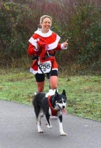 Run Mummy Run Canicross Woman running with a dog