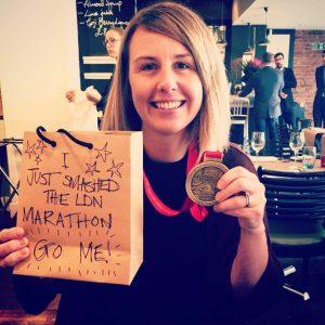Aisling Gray holding London Marathon medal Run Mummy Run