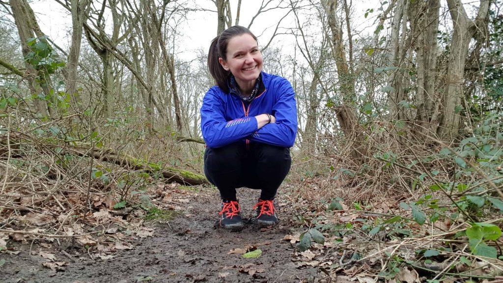 Leanne Davies from Run Mummy Run crouching in Inov8 Mudclaws