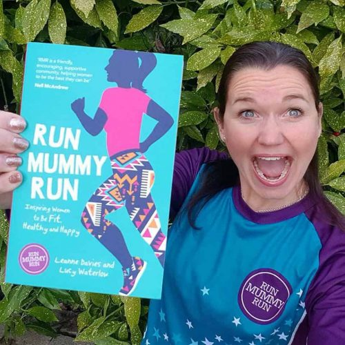 Leanne Davies holding the Run Mummy Run book in Run Mummy Run kit
