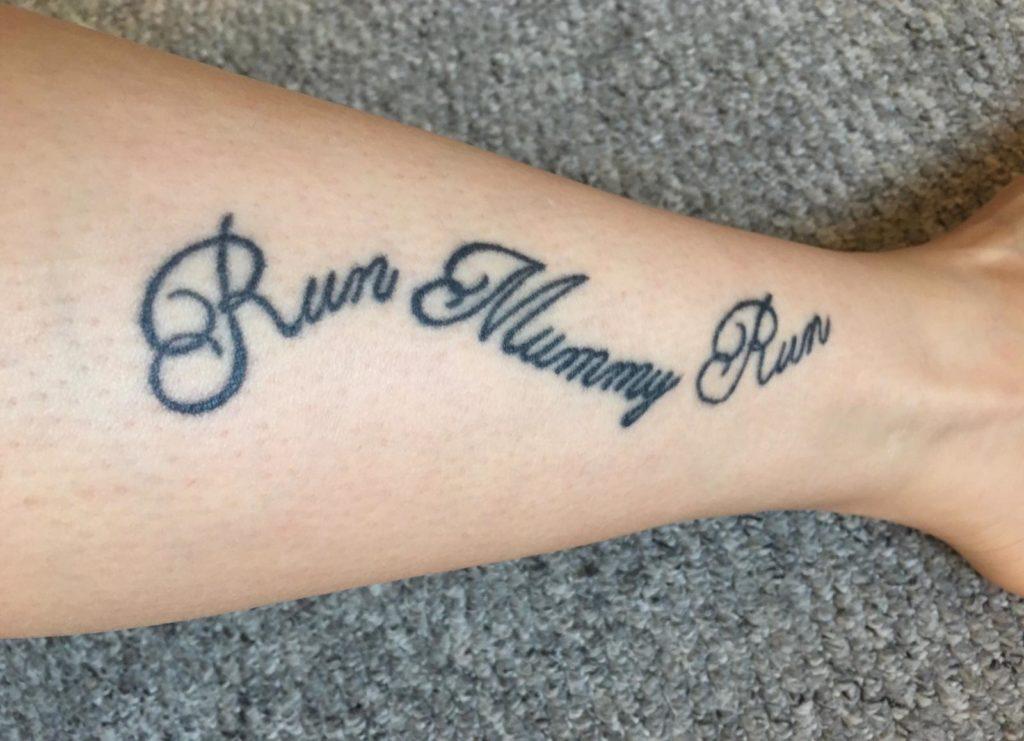 Run Mummy Run tattooed on women's arm